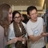 Jerry Gu has a an attentive audience at his poster