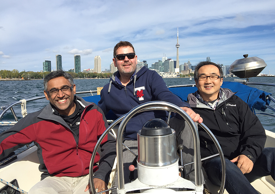 Ramanujan Hegde (centre) enjoys some down time with captain Angus McQuibban and first mate Peter Kim. Yes, we do treat our seminar speakers well!