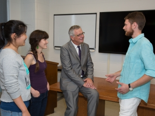 An image of Professor Reithmeier with students.