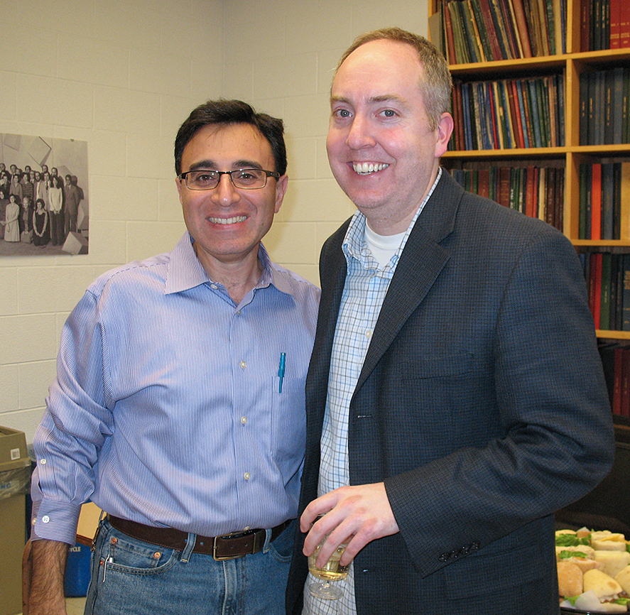 Cole Haynes (right) relaxes with host Walid Houry at a reception following his seminar.