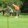 Michael Ohh checks the line as Jeff Charuk putts