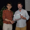 Grad Coordinator Angus McQuibban presents the David A. Scott award for top all-round grad student to Shawn Xiong